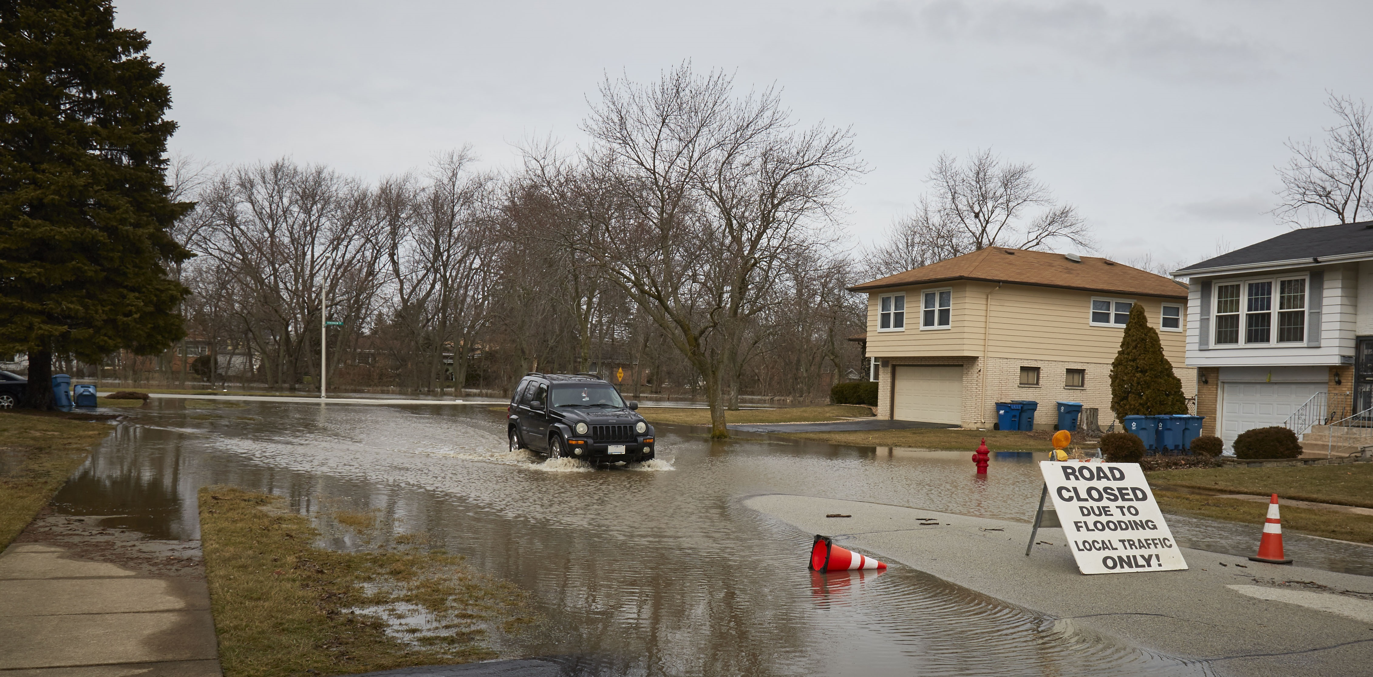 Car driving through flooded street photo