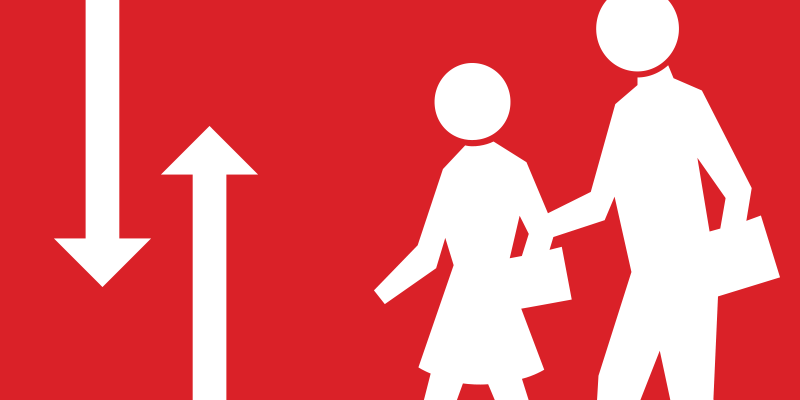 Traffic Safety image of two directional arrows and people silhouettes