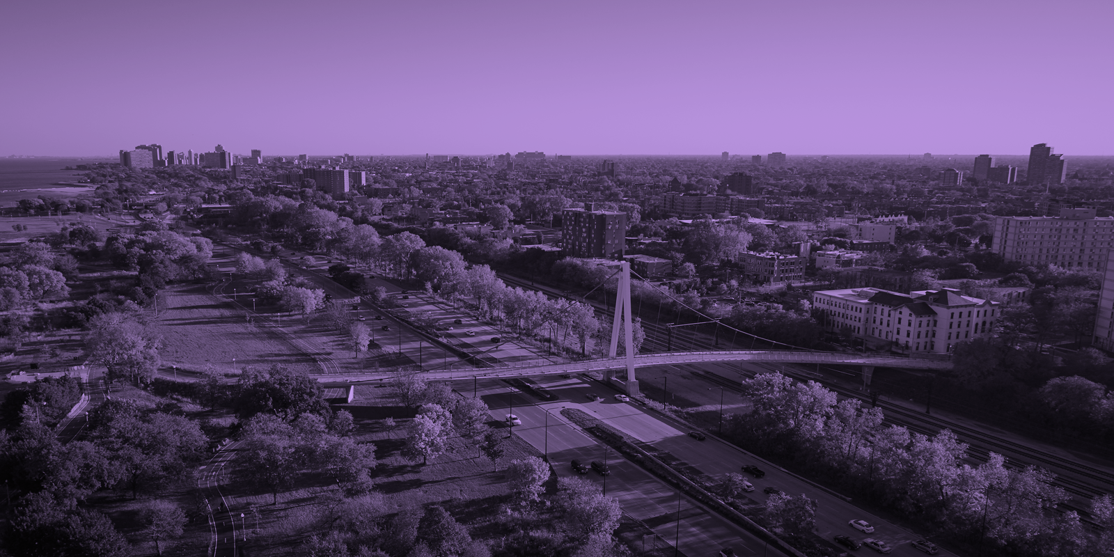 Image of an urban area, with a purple overlay