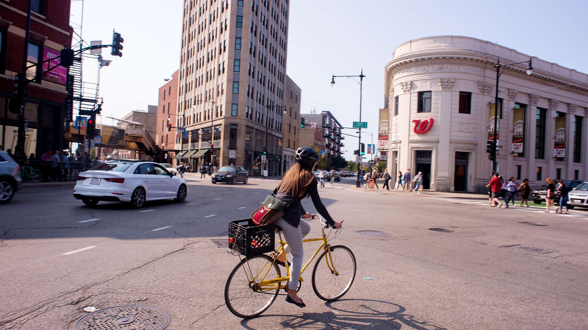 Photo of intersection in Wicker Park with woman riding her bike