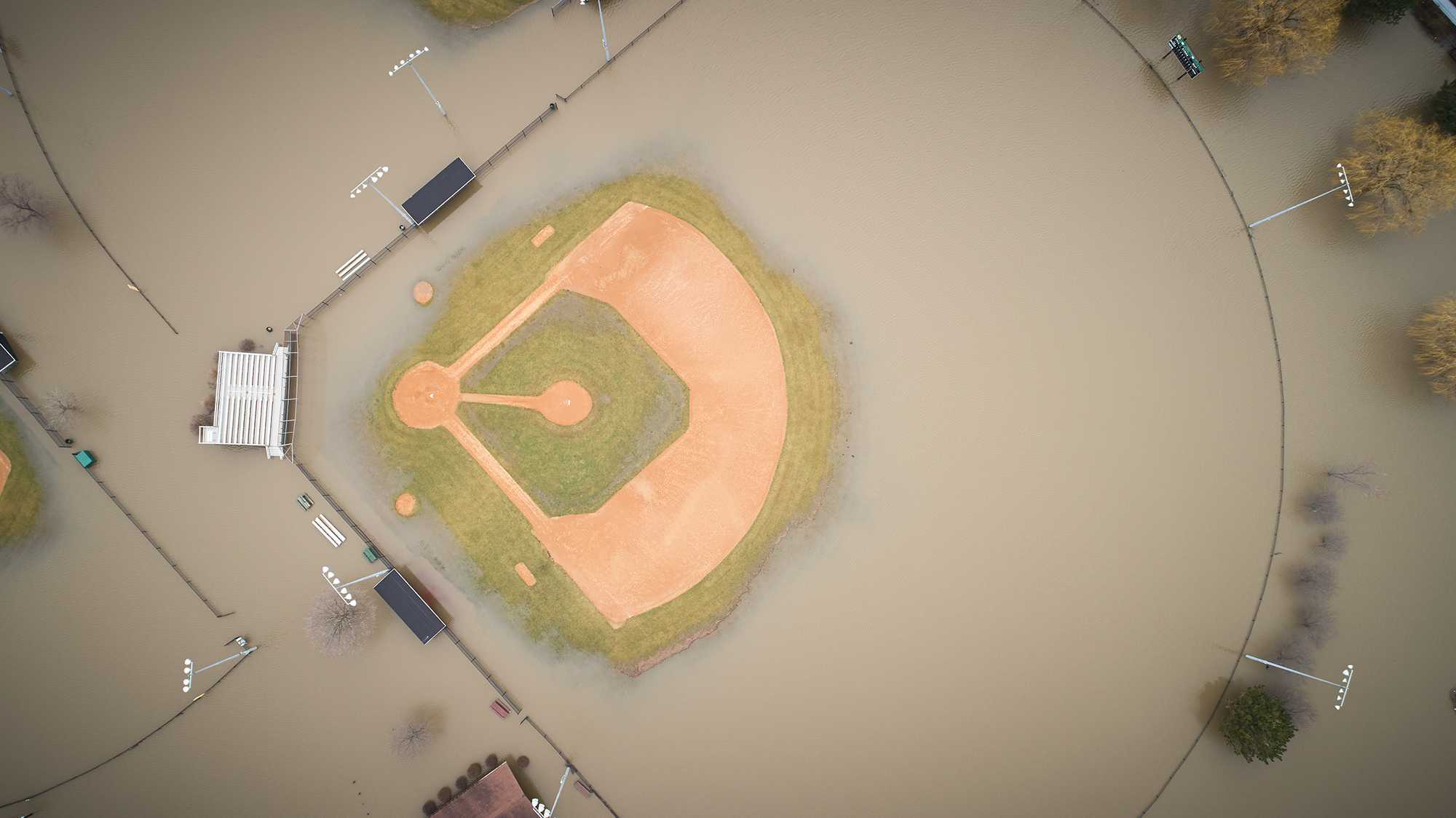 Flooded baseball diamond from above.