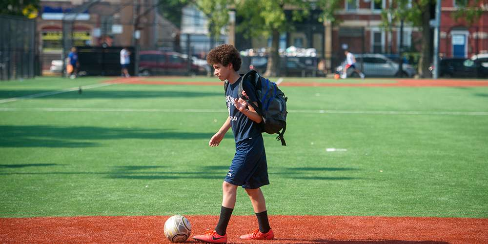 Young man playing soccer in Chicago.